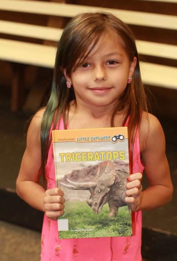 "Donors Choose Book ""Triceratops"" held by girl"