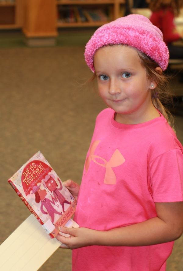"Donors Choose Book ""We Go Together"" held by girl"