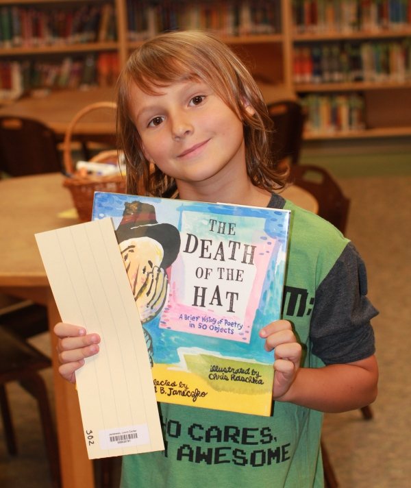 "Donors Choose Book ""The Death of the Hat"" held by boy"