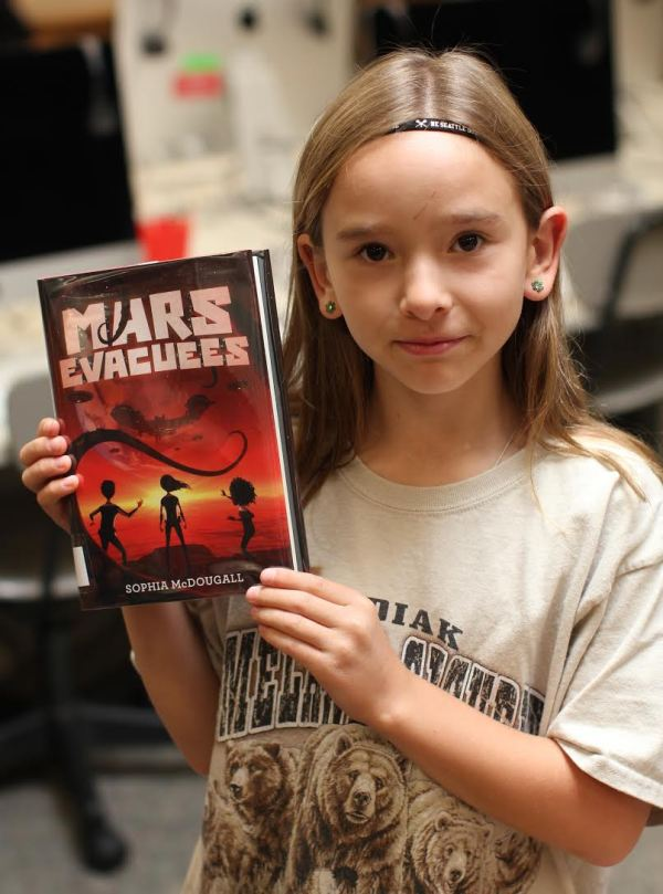 "Donors Choose Book ""Mars Evacuees"" held by girl"