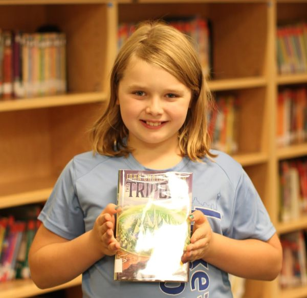 "Donors Choose Book ""Tripods"" held by girl"