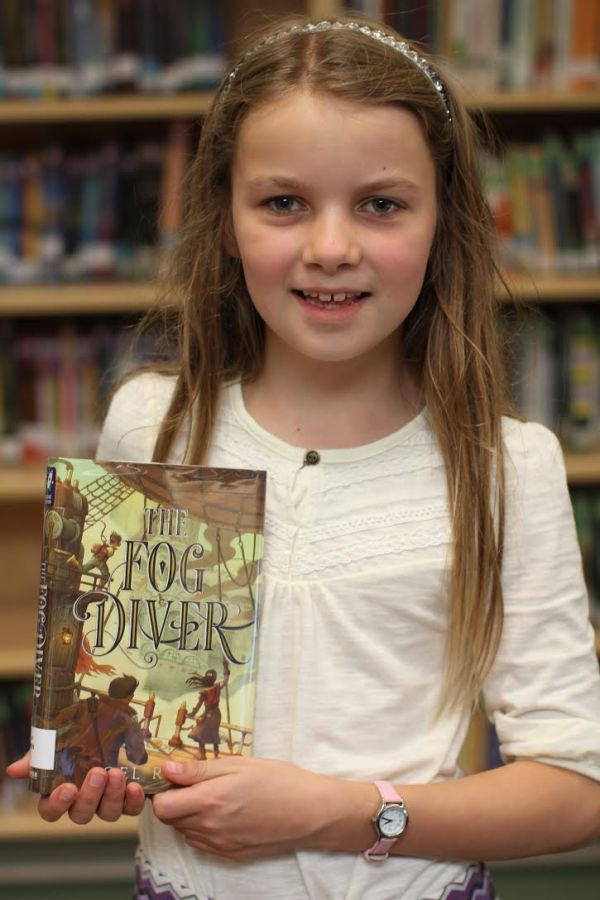"Donors Choose Book ""The Fog Diver"" held by girl"