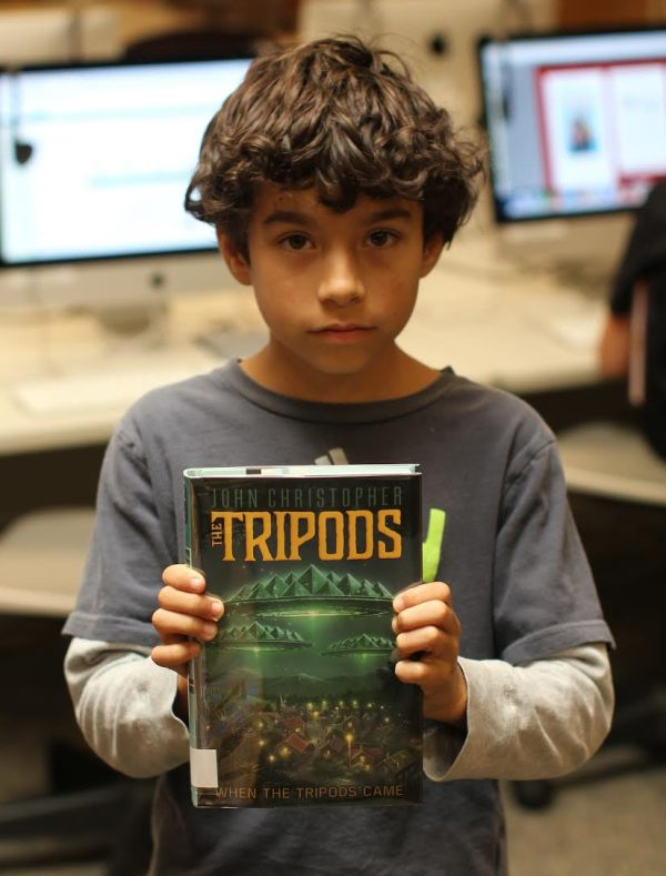 "Donors Choose Book ""Tripods"" held by boy"