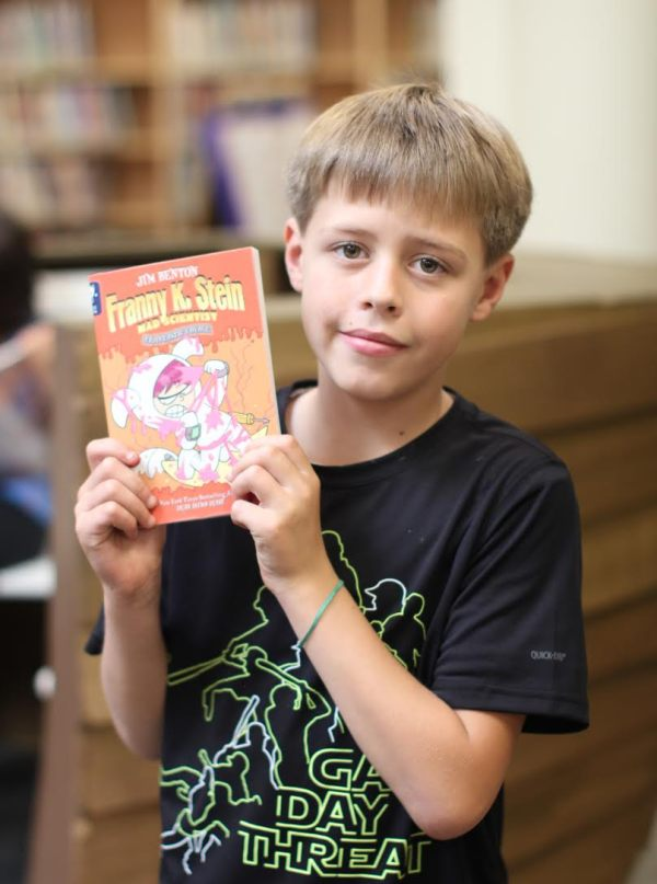"Donors Choose Book ""Franny K Stein"" held by boy"