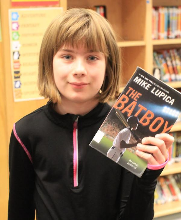 "Donors Choose Book ""The Batboy"" held by girl"
