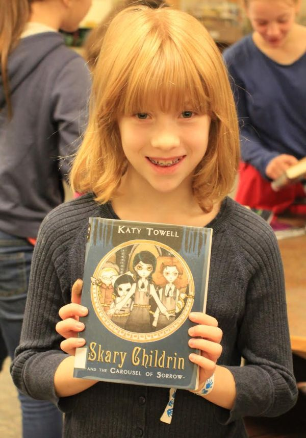 "Donors Choose Book ""Skary Childrin"" held by girl"