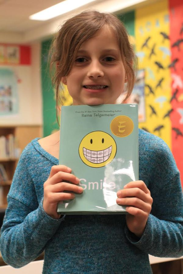 "Donors Choose Book ""Smile"" held by girl"