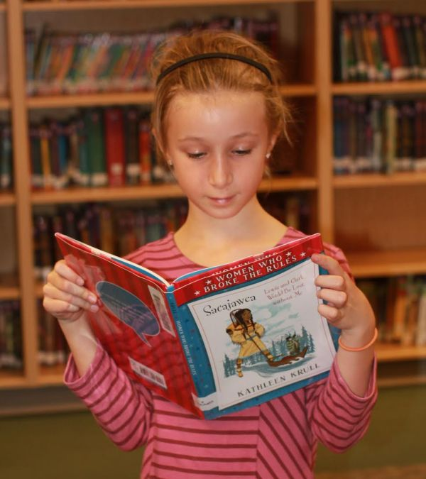 "Donors Choose Book ""Sacajawea"" held by girl"