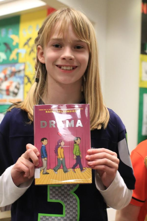 "Donors Choose Book ""Drama"" held by girl"