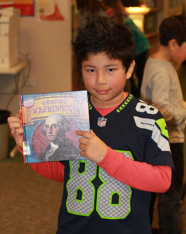 "Donors Choose Book ""George Washington"" held by boy."