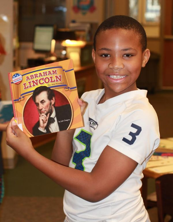 "Donors Choose Book ""Abraham Lincoln"" held by boy"