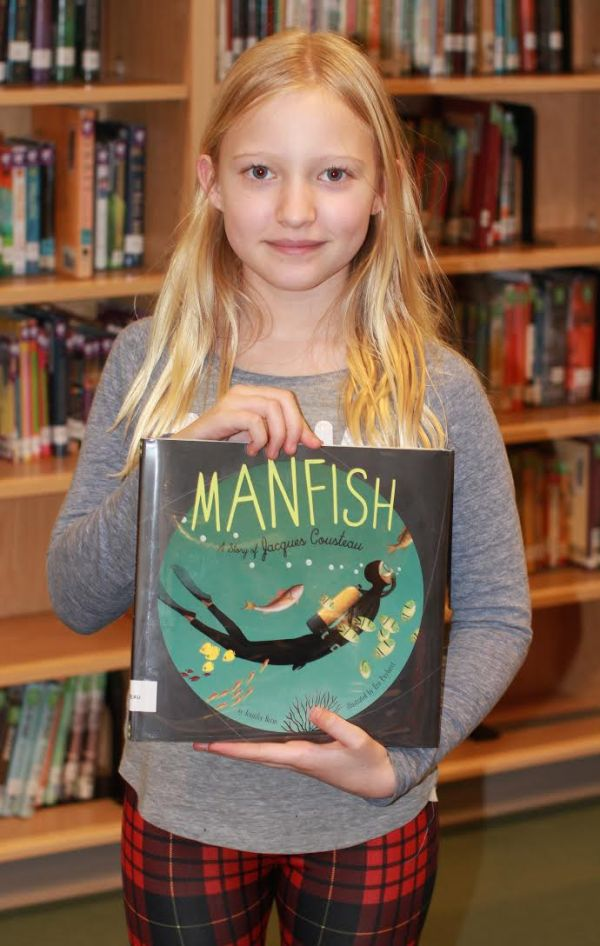 "Donors Choose Book ""Manfish"" held by girl"