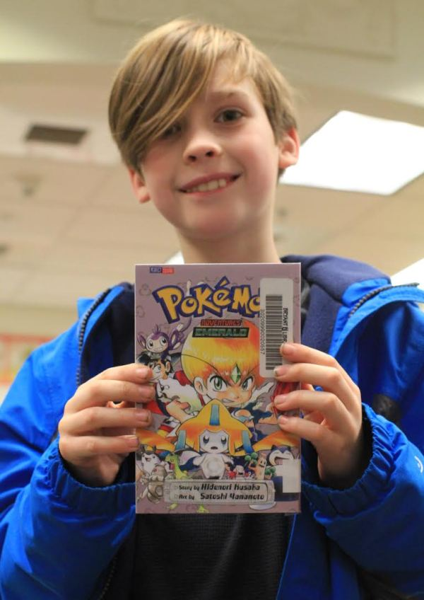 "Donors Choose Book ""Pokemon"" held by girl"