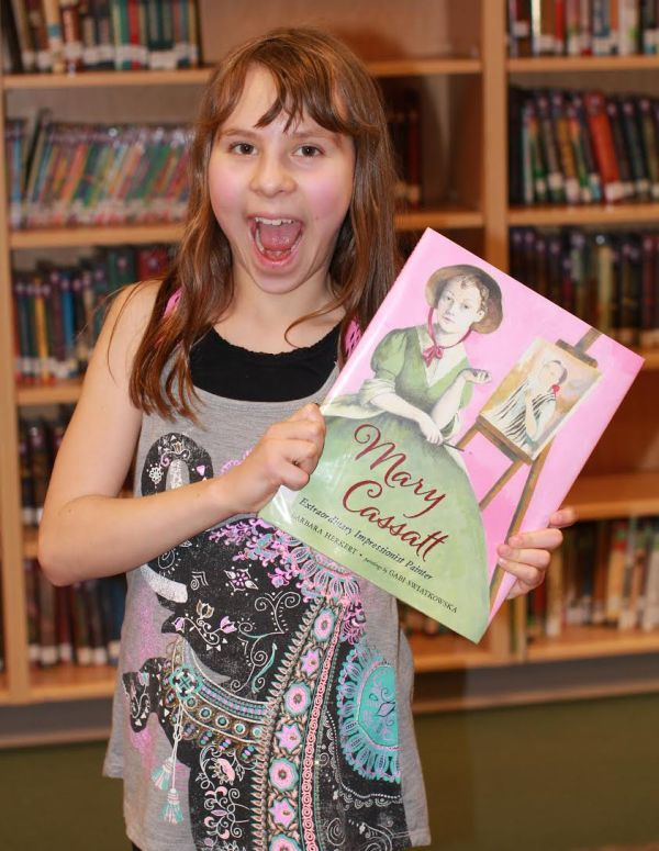 "Donors Choose Book ""Mary Cassatt"" held by girl"