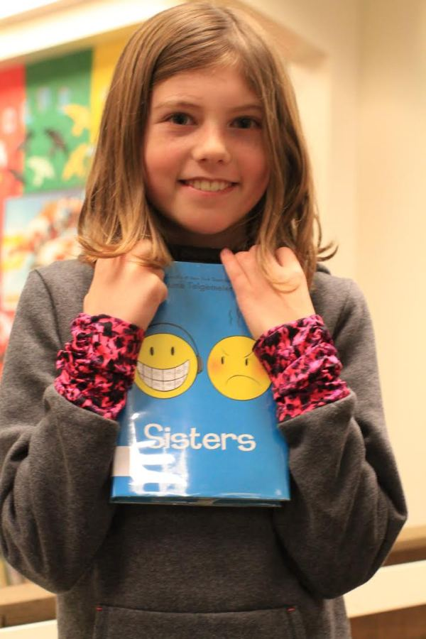 "Donors Choose Book ""Sisters"" held by girl"