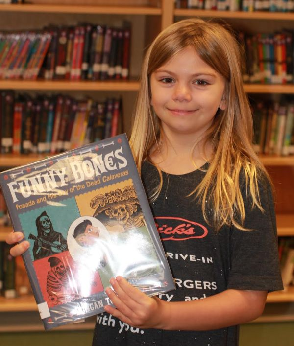 "Donors Choose Book ""Funny Bones"" held by girl"