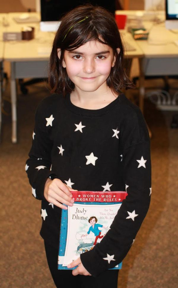 "Donors Choose Book ""Judy Blume"" held by girl"