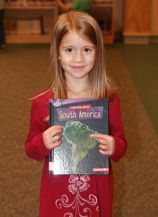 "Donors Choose Book ""South America"" held by girl"