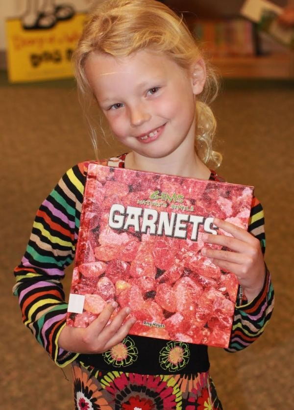 "Donors Choose Book ""Garnets"" held by girl"
