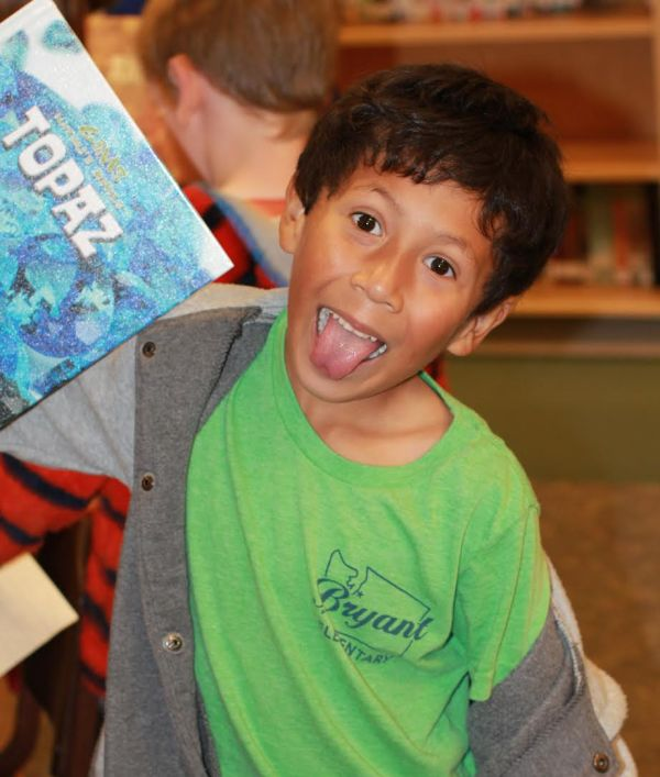"Donors Choose Book ""Topaz"" held by boy"