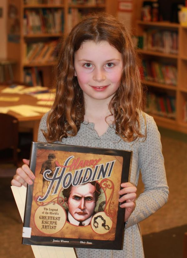 "Donors Choose Book ""Harry Houdini"" held by girl"