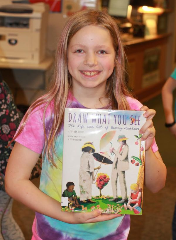 "Donors Choose Book ""Draw What You See"" held by girl"