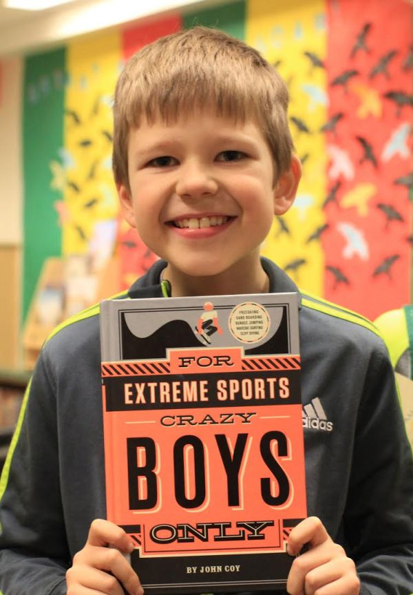 "Donors Choose Book ""For Extreme Sports Crazy Boys Only"" held by boy"